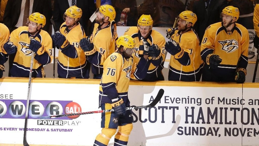 Nashville Predators defenseman P.K. Subban (76) is congratulated after scoring a goal against the Columbus Blue Jackets during the second period of an NHL hockey preseason game, Tuesday, Oct. 4, 2016, in Nashville, Tenn. (AP Photo/Mark Humphrey)