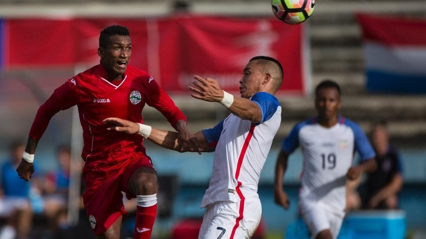 Bobby Wood of the U.S heads the ball against Cuba´s David Urgelles, during a friendly soccer match in the Pedro Marrero Stadium in Havana, Cuba, Friday, Oct. 7, 2016. The U.S. beat Cuba 0-2.  (AP Photo/Desmond Boylan)