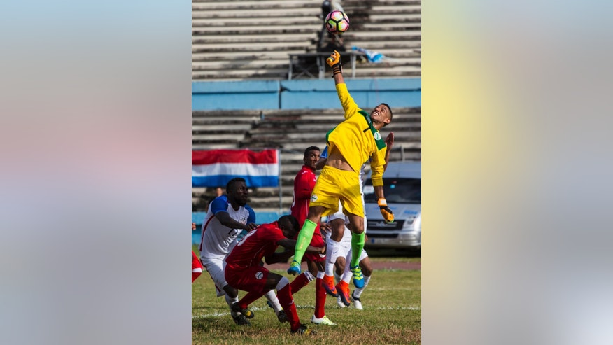Cuba goalkeeper Sandy Sanchez hits the ball during a friendly soccer match against the United States, in the Pedro Marrero Stadium in Havana, Cuba, Friday, Oct. 7, 2016. The U.S. beat Cuba 0-2.  (AP Photo/Desmond Boylan)