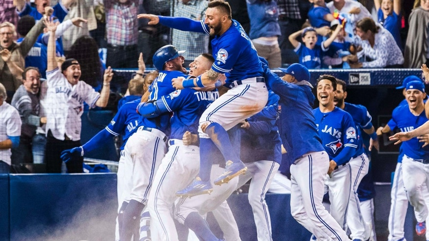 Oct. 9, 2016: Toronto Blue Jays players celebrate their walk-off win to eliminate the Texas Rangers during the tenth inning to win the American League Division Series in Toronto.