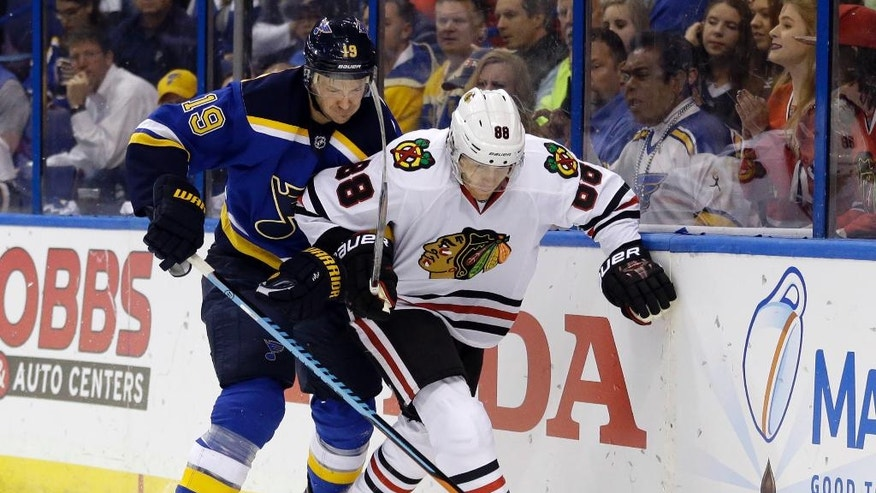 FILE - In this April 21, 2016, file photo, St. Louis Blues' Jay Bouwmeester, left, and Chicago Blackhawks' Patrick Kane chase the puck during the first period in Game 5 of an NHL hockey first-round Stanley Cup playoff series in St. Louis. Kane is one of the top players to watch in the 2016-17 season. (AP Photo/Jeff Roberson, File)
