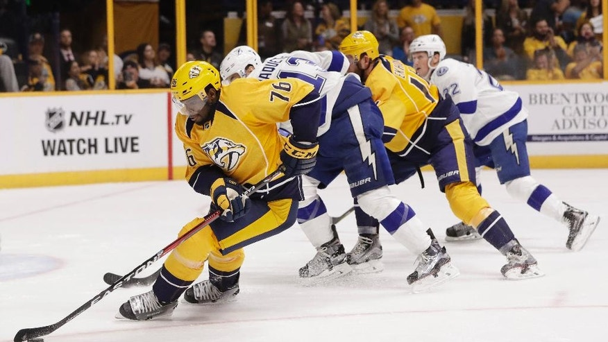 FILE - In this Oct. 1, 2016, file photo, Nashville Predators defenseman P.K. Subban (76) clears the puck away from Tampa Bay Lightning center Cedric Paquette (13) during the third period of an NHL hockey preseason game in Nashville, Tenn. Subban is one of the top players to watch in the 2016-17 season. (AP Photo/Mark Humphrey, File)