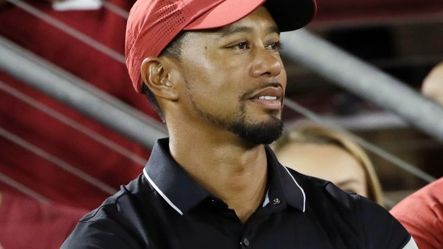 FILE - In this Oct. 8, 2016, file photo, golfer Tiger Woods, left, watches an NCAA college football game between Stanford and Washington State, in Stanford, Calif. The comeback of Tiger Woods is going to have to wait at least two more months. Three days before he was to return at the Safeway Open, Woods said he wasn't ready to return against PGA Tour competition. Along with pulling out of the Safeway Open, Woods said Monday , Oct. 10, 2016, he was withdrawing from the Turkish Airlines Open next month.(AP Photo/Marcio Jose Sanchez, File)