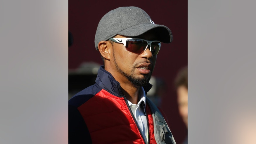 FILE - In this Sept. 27, 2016, file photo, United States vice-captain Tiger Woods watches a practice round for the Ryder Cup golf tournament, at Hazeltine National Golf Club in Chaska, Minn. The comeback of Tiger Woods is going to have to wait at least two more months. Three days before he was to return at the Safeway Open, Woods said he wasn't ready to return against PGA Tour competition. Along with pulling out of the Safeway Open, Woods said Monday , Oct. 10, 2016, he was withdrawing from the Turkish Airlines Open next month. (AP Photo/Chris Carlson, File)