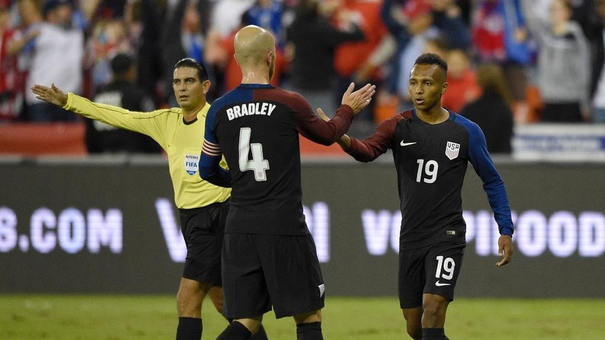 U.S. forward Julian Green (19) celebrates his goal with midfielder Michael Bradley (4) during the first half of an international friendly soccer match against New Zealand, Tuesday, Oct. 11, 2016, in Washington. (AP Photo/Nick Wass)