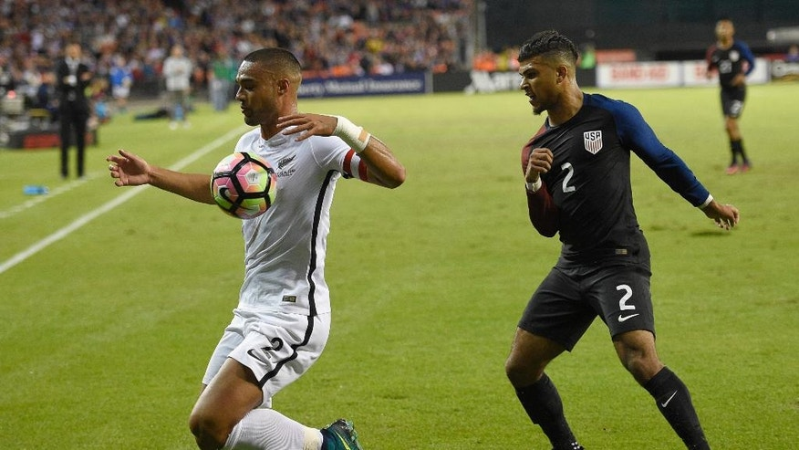 New Zealand defender Winston Reid, left, chases the ball against U.S. defender DeAndre Yedlin, right, during the first half of an international friendly soccer match Tuesday, Oct. 11, 2016, in Washington. (AP Photo/Nick Wass)