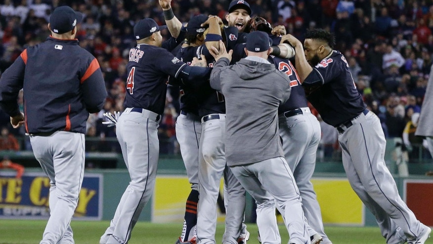 The Cleveland Indians celebrate their 4-3 win over the Boston Red Sox in Game 3 of baseball's American League Division Series, Monday, Oct. 10, 2016, in Boston.