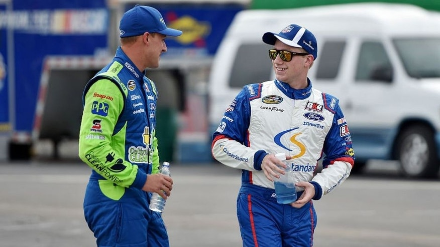 SPARTA, KY - JULY 07: Daniel Hemric, driver of the #19 Oakmont Management Group Ford, talks to Tyler Reddick, driver of the #29 Cooper Standard Ford, during qualifying for the NASCAR Camping World Truck Series Buckle Up In Your Truck 225 at Kentucky Speedway on July 7, 2016 in Sparta, Kentucky. (Photo by Drew Hallowell/NASCAR via Getty Images)