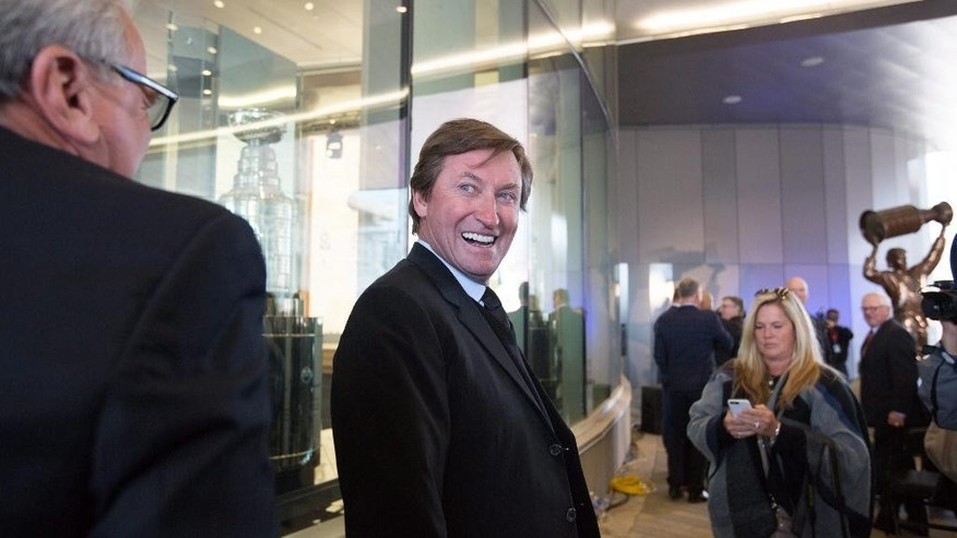 Wayne Gretzky laughs at the unveiling of the Wayne Gretzky statue and Hall of Fame room in Edmonton, Alberta, on Wednesday Oct. 12, 2016. (Amber Bracken/The Canadian Press via AP)