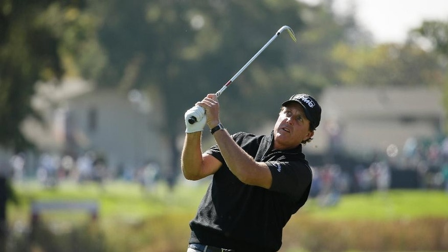 Phil Mickelson follows his approach shot from the first fairway of the Silverado Resort North Course during the pro-am event of the Safeway Open PGA golf tournament Wednesday, Oct. 12, 2016, in Napa, Calif. (AP Photo/Eric Risberg)