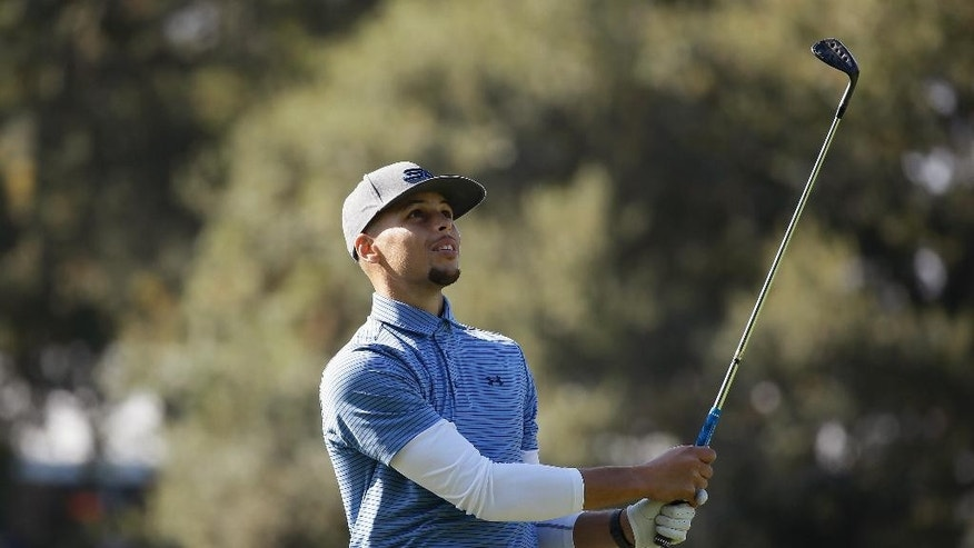 Golden State Warriors' Stephen Curry follows his shot from the 14th fairway of the Silverado Resort North Course during the pro-am event of the Safeway Open PGA golf tournament Wednesday, Oct. 12, 2016, in Napa, Calif. (AP Photo/Eric Risberg)