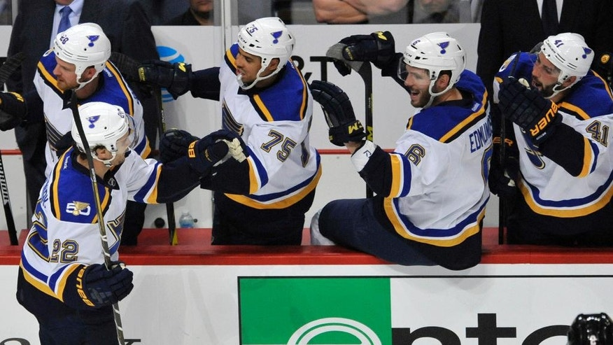 St. Louis Blues' Kevin Shattenkirk (22) celebrates with teammates on the bench after scoring a goal during the second period of a hockey game against the Chicago Blackhawks on Wednesday, Oct. 12, 2016, in Chicago. (AP Photo/Paul Beaty)