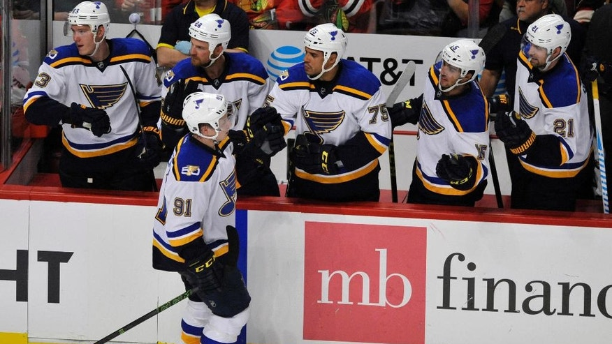 St. Louis Blues' Vladimir Tarasenko (91), of Russia, celebrates with teammates on the bench after scoring during the second period of an NHL hockey game against the Chicago Blackhawks on Wednesday, Oct. 12, 2016, in Chicago. St. Louis won 5-2. (AP Photo/Paul Beaty)