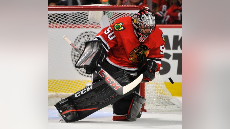 Chicago Blackhawks goalie Corey Crawford makes a save during the first period of an NHL hockey game against the St. Louis Blues on Wednesday, Oct. 12, 2016, in Chicago. (AP Photo/Paul Beaty)
