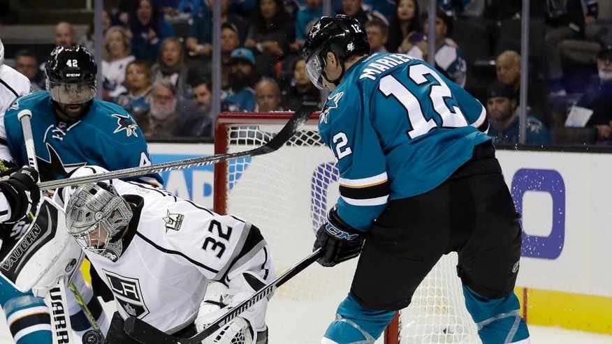 Los Angeles Kings goalie Jonathan Quick (32) stops a shot from San Jose Sharks left wing Patrick Marleau (12) during the first period of an NHL hockey game Wednesday, Oct. 12, 2016, in San Jose, Calif. (AP Photo/Marcio Jose Sanchez)