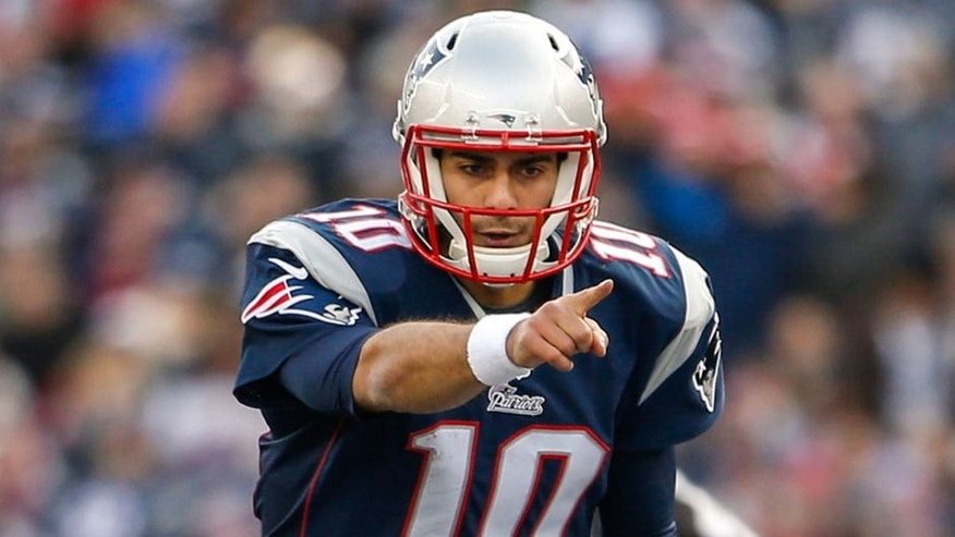 Dec 28, 2014; Foxborough, MA, USA; New England Patriots quarterback Jimmy Garoppolo (10) on the field against the Buffalo Bills in the second half at Gillette Stadium. Buffalo Bills defeated the Patriots 17-9. Mandatory Credit: David Butler II-USA TODAY Sports