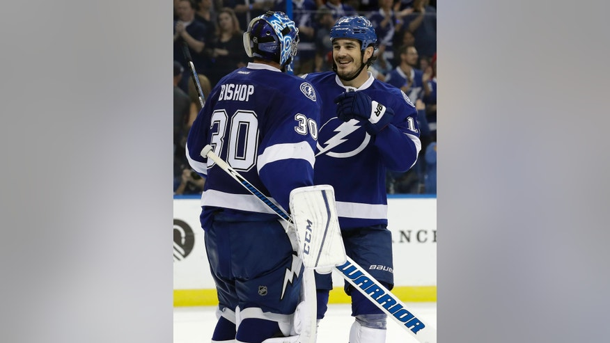Tampa Bay Lightning goalie Ben Bishop (30) celebrates with center Brian Boyle (11) after they defeated the Detroit Red Wings in an NHL hockey game Thursday, Oct. 13, 2016, in Tampa, Fla. (AP Photo/Chris O'Meara)