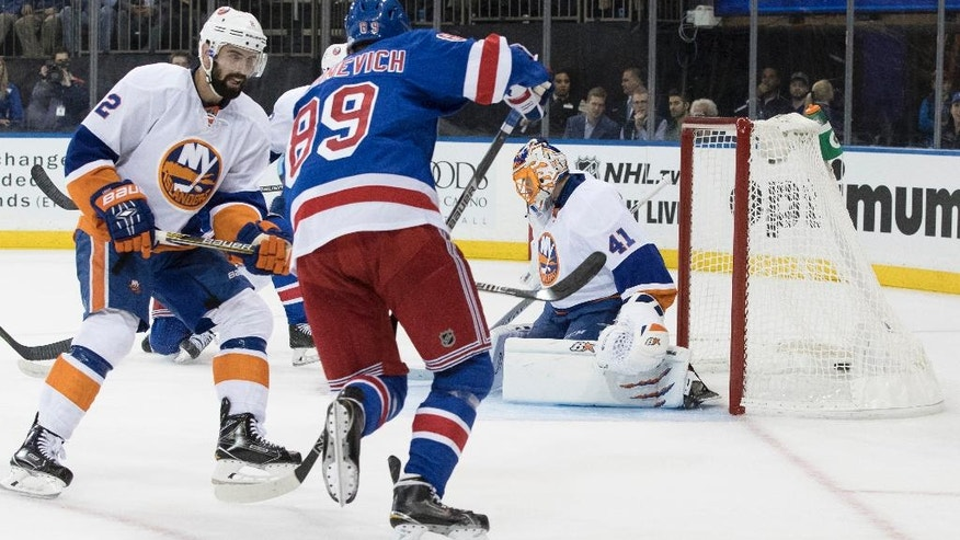 New York Islanders goalie Jaroslav Halak (41) watches as the puck hits the net after New York Rangers right wing Mats Zuccarello, not seen, scored a goal during the second period of an NHL hockey game, Thursday, Oct. 13, 2016, at Madison Square Garden in New York. (AP Photo/Mary Altaffer)