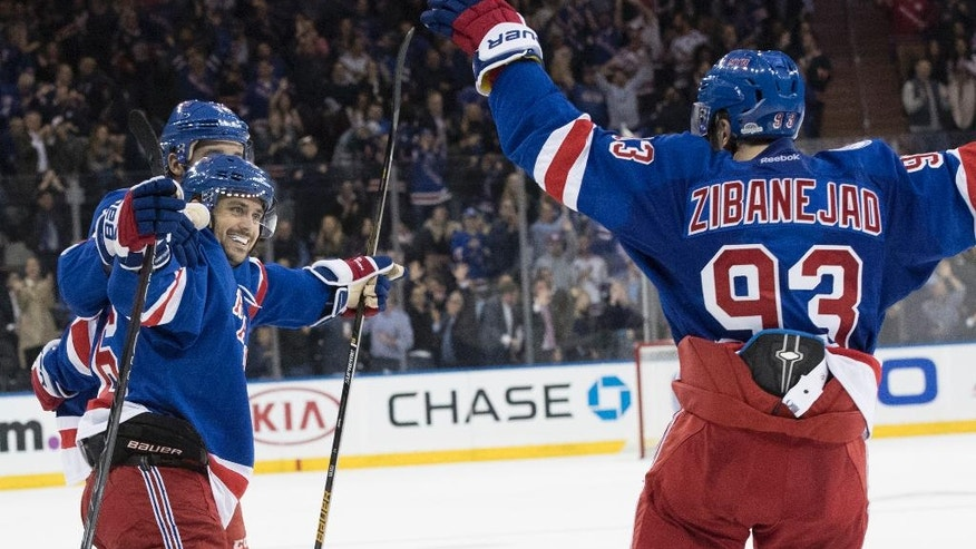 New York Rangers right wing Mats Zuccarello, left, celebrates with center Mika Zibanejad (93) after scoring a goal against the New York Islanders during the second period of an NHL hockey game, Thursday, Oct. 13, 2016, at Madison Square Garden in New York. (AP Photo/Mary Altaffer)