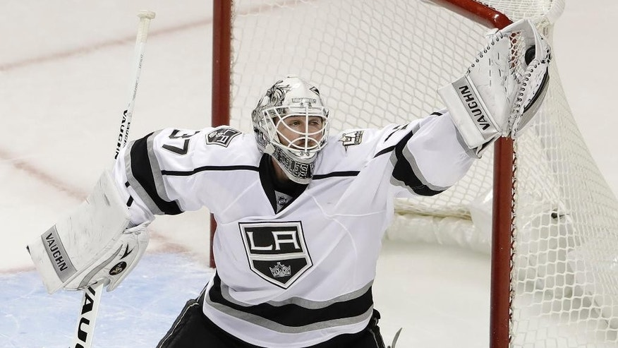 Los Angeles Kings goalie Jeff Zatkoff (37) stops a shot against the San Jose Sharks during the third period of an NHL hockey game Wednesday, Oct. 12, 2016, in San Jose, Calif. San Jose won 2-1. (AP Photo/Marcio Jose Sanchez)