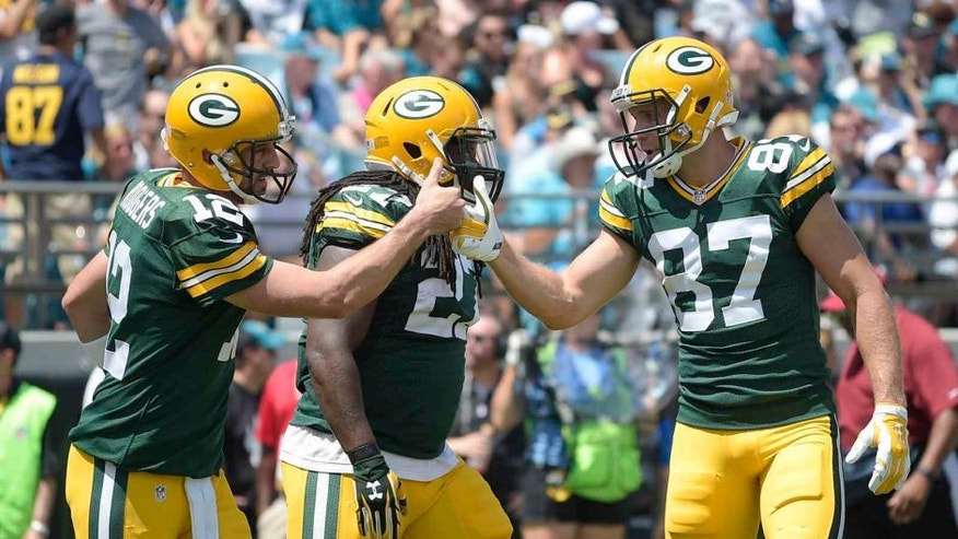 Sunday, Sept. 11: Green Bay Packers quarterback Aaron Rodgers (left) celebrates his touchdown run against the Jacksonville Jaguars with wide receiver Jordy Nelson during the first half in Jacksonville, Fla. The Packers won 27-23.