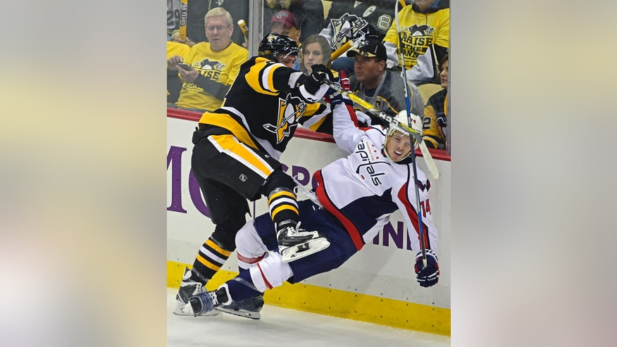 Pittsburgh Penguins left wing Carl Hagelin, left, checks Washington Capitals defenseman John Carlson (74) during the second period of an NHL hockey game Thursday, Oct. 13, 2016, in Pittsburgh, Pa. (AP Photo/Fred Vuich)