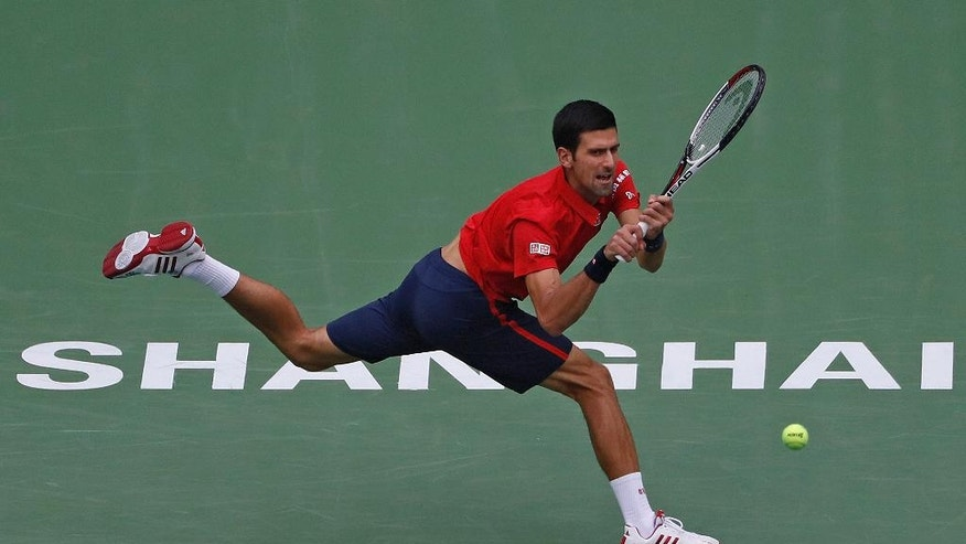 Novak Djokovic of Serbia hits a return shot against Misha Zverev of Germany during the men's singles quarterfinals of the Shanghai Masters tennis tournament at Qizhong Forest Sports City Tennis Center in Shanghai, China, Friday, Oct. 14, 2016. (AP Photo/Andy Wong)