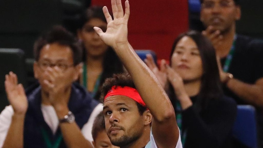 Jo-Wilfried Tsonga of France waves to spectators after defeat by Roberto Bautista Agut of Spain in the men's singles quarterfinals of the Shanghai Masters tennis tournament at Qizhong Forest Sports City Tennis Center in Shanghai, China, Friday, Oct. 14, 2016. (AP Photo/Andy Wong)