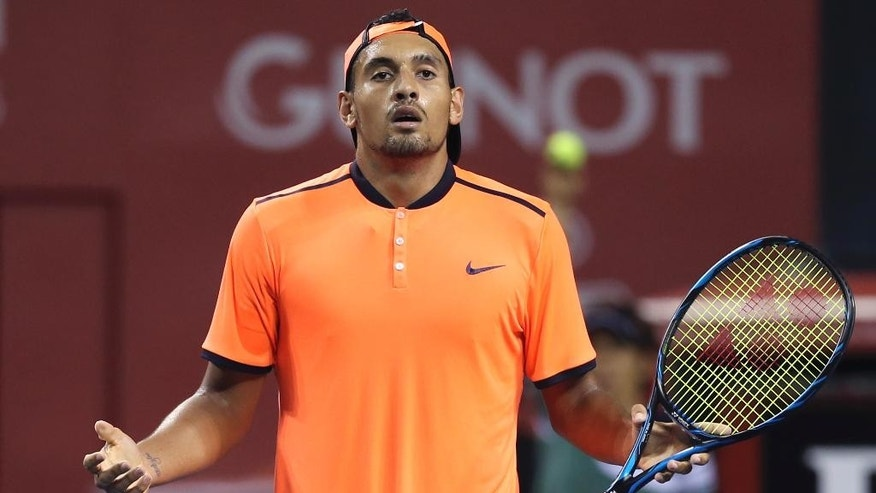 "FILE - In this Saturday, Oct. 8, 2016, file photo, Australia's Nick Kyrgios reacts after getting a point against Gael Monfils of France during the semifinal match of Japan Open tennis championships in Tokyo. Kyrgios was booed during a listless 6-3, 6-1 loss to Mischa Zverev at the Shanghai Masters on Wednesday, Oct. 12, 2016, then angrily defended his behavior by saying he didn't owe the spectators anything and fans could ""just leave"" if they didn't like his attitude. (AP Photo/Koji Sasahara, File)"