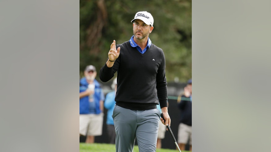 Scott Piercy waves after making a birdie putt on the first green of the Silverado Resort North Course during the first round of the Safeway Open golf tournament Thursday, Oct. 13, 2016, in Napa, Calif. (AP Photo/Eric Risberg)