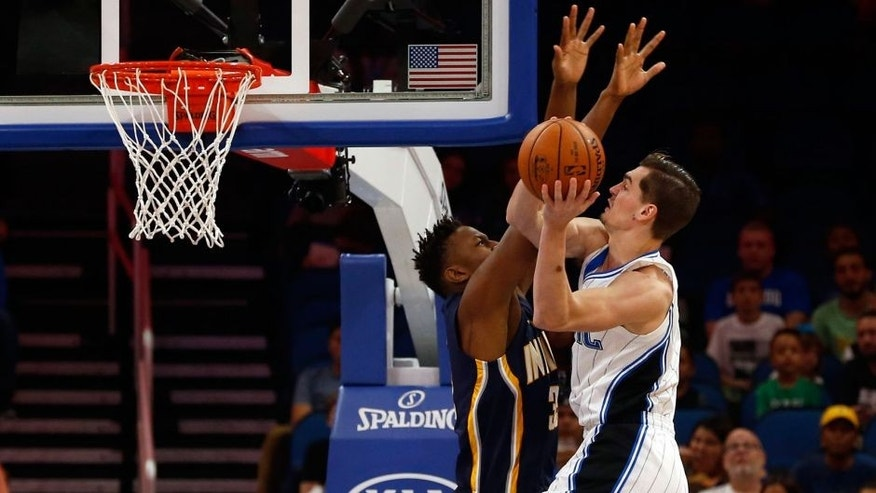 Oct 14, 2016; Orlando, FL, USA; Orlando Magic guard Mario Hezonja (8) shoots around Indiana Pacers forward Myles Turner (33) during the first quarter at Amway Center. Mandatory Credit: Kim Klement-USA TODAY Sports