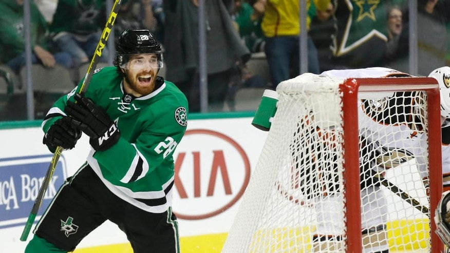 Dallas Stars defenseman Stephen Johns (28) celebrates after scoring a goal during the first period of an NHL hockey game against Anaheim Ducks, Thursday, Oct. 13, 2016, in Dallas. (AP Photo/LM Otero)