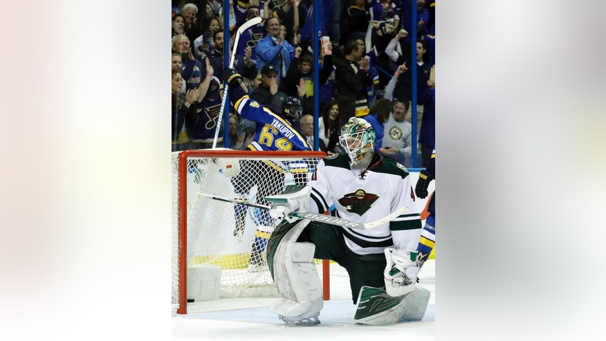 St. Louis Blues's Nail Yakupov (64), of Russia, celebrates after scoring past Minnesota Wild goalie Devan Dubnyk during the second period of an NHL hockey game Thursday, Oct. 13, 2016, in St. Louis. (AP Photo/Jeff Roberson)