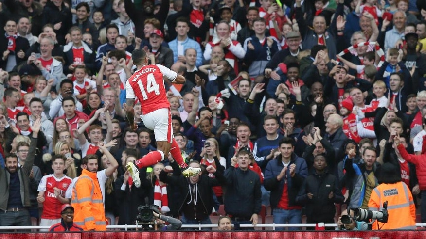 Arsenal's Theo Walcott celebrates after scoring his team's second goal during the English Premier League soccer match between Arsenal and Swansea City at The Emirates Stadium in London, Saturday Oct. 15, 2016. (AP Photo/Tim Ireland)