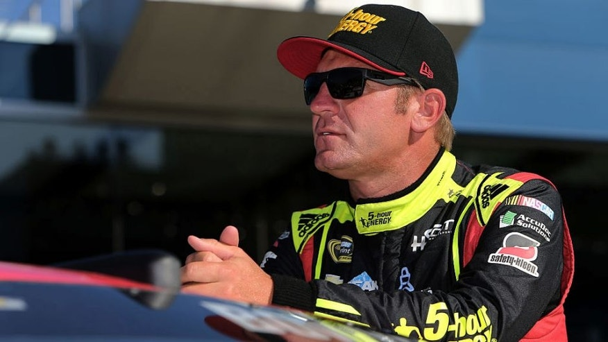 BROOKLYN, MI - AUGUST 26: Clint Bowyer, driver of the #15 5-hour Energy Chevrolet, stands on the grid during qualifying for the NASCAR Sprint Cup Series Pure Michigan 400 at Michigan International Speedway on August 26, 2016 in Brooklyn, Michigan. (Photo by Rey Del Rio/Getty Images)