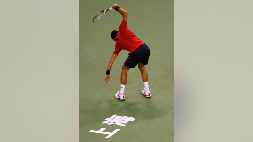 Novak Djokovic of Serbia smashes his racquet in frustration during the men's singles semifinals match against Roberto Bautista Agut of Spain in the Shanghai Masters tennis tournament at Qizhong Forest Sports City Tennis Center in Shanghai, China, Saturday, Oct. 15, 2016. (AP Photo/Andy Wong)