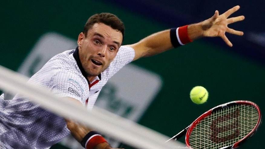 Roberto Bautista Agut of Spain hits a return shot against Novak Djokovic of Serbia during the men's singles semifinals match of the Shanghai Masters tennis tournament at Qizhong Forest Sports City Tennis Center in Shanghai, China, Saturday, Oct. 15, 2016. (AP Photo/Andy Wong)
