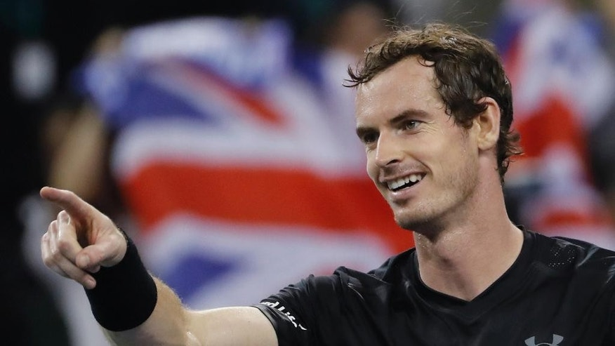 Andy Murray of Britain celebrates after defeating Gilles Simon of France in the men's singles semifinals match of the Shanghai Masters tennis tournament at Qizhong Forest Sports City Tennis Center in Shanghai, China, Saturday, Oct. 15, 2016. (AP Photo/Andy Wong)