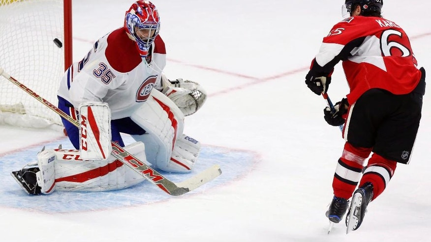 Ottawa Senators' Erik Karlsson (65) shoots the puck past Montreal Canadiens goalie Al Montoya (35) for a goal in the shootout of an NHL hockey game Saturday, Oct. 15, 2016, in Ottawa, Ontario. (Fred Chartrand/The Canadian Press via AP)
