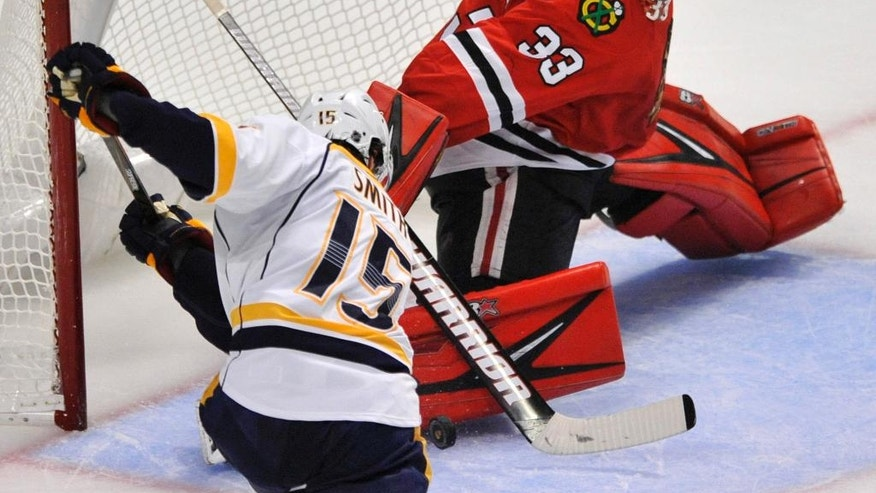 Chicago Blackhawks goalie Scott Darling (33) makes a save against Nashville Predators' Craig Smith (15) during the second period of an NHL hockey game Saturday, Oct. 15, 2016, in Chicago. (AP Photo/Paul Beaty)
