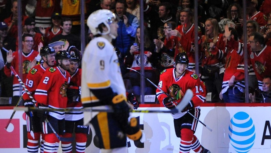 Chicago Blackhawks' Richard Panik (14) celebrates after scoring a goal during the first period of an NHL hockey game against the Nashville Predators, Saturday, Oct. 15, 2016, in Chicago. (AP Photo/Paul Beaty)