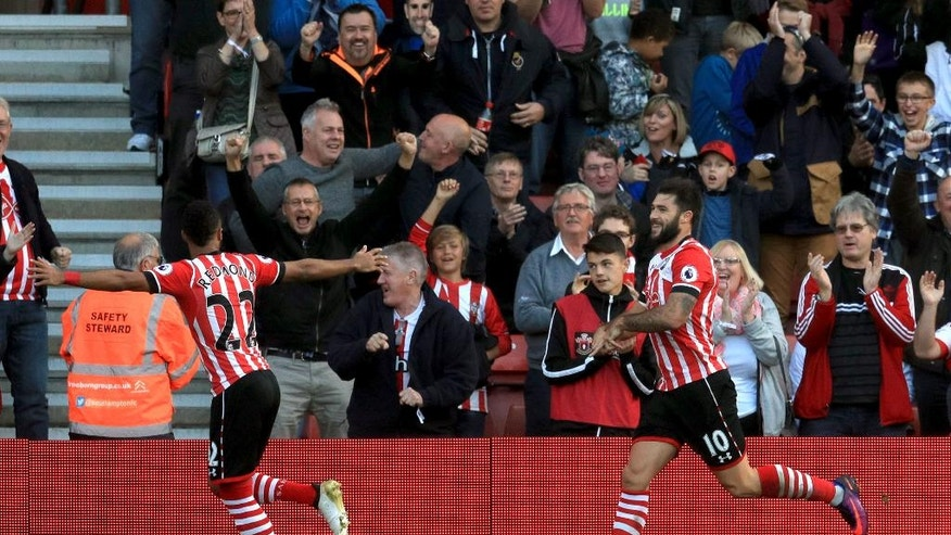 Southampton's Charlie Austin, right, celebrates scoring his side's first goal of the game with teammate Nathan Redmond during their English Premier League soccer match against Burnley at St Mary's, Southampton, England, Sunday, Oct. 16, 2016. (Adam Davy/PA via AP)