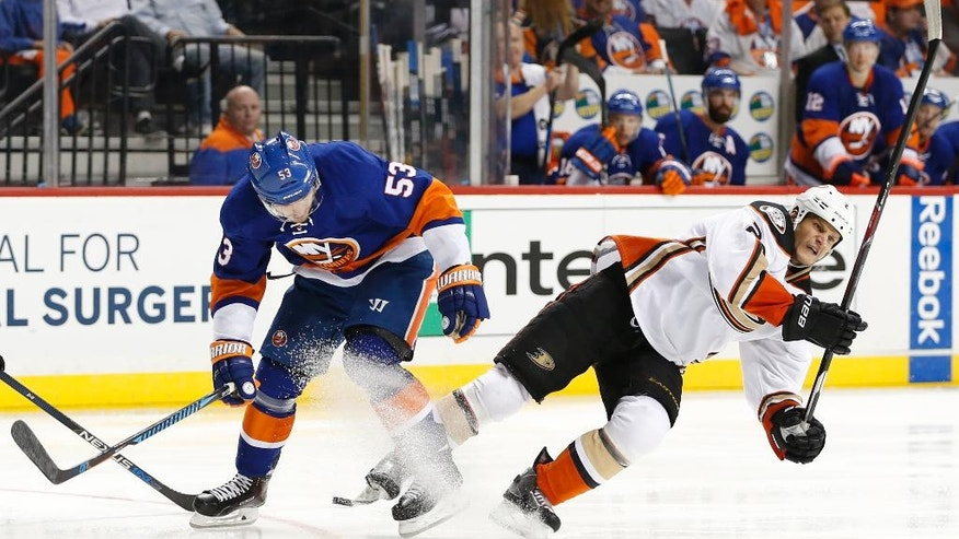 CORRECTS TO SECOND PERIOD NOT FIRST New York Islanders center Casey Cizikas (53) becomes entangled with Anaheim Ducks defenseman Kevin Bieksa (2) during the second period of an NHL hockey game, Sunday, Oct. 16, 2016, in New York. (AP Photo/Kathy Willens)