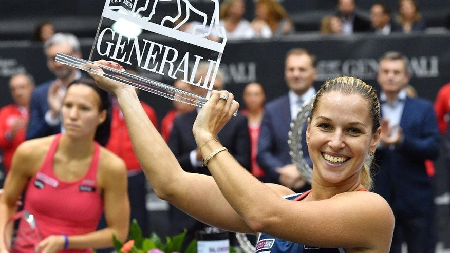 Slovakia's winner Dominika Cibulkova poses with her trophy after her final match against Switzerland's Viktorija Golubic  at the Generali Ladies tennis tournament in Linz,  Austria, Sunday, Oct. 16, 2016.  (AP Photo/Kerstin Joensson)