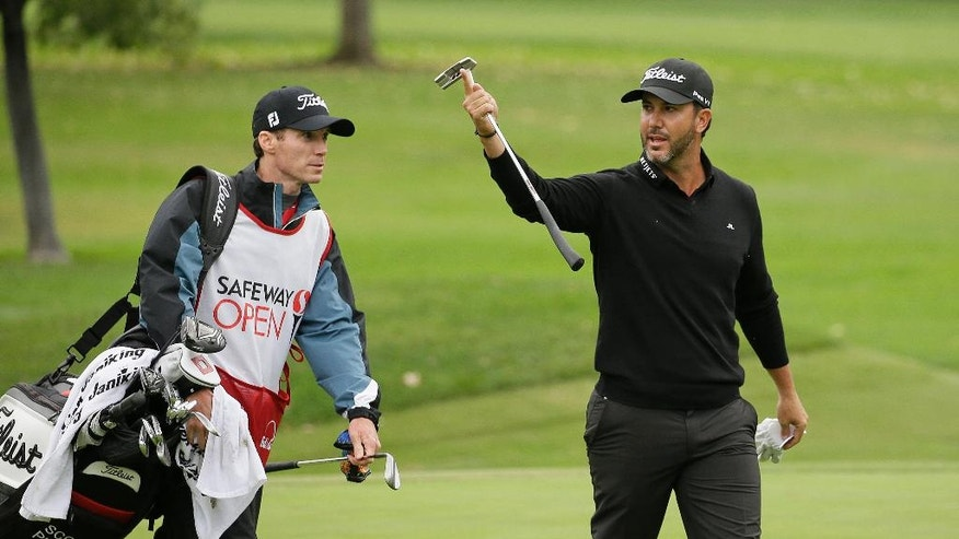 Scott Piercy raises his putter while walking up to the sixth green of the Silverado Resort North Course during the third round of the Safeway Open PGA golf tournament Saturday, Oct. 15, 2016, in Napa, Calif. (AP Photo/Eric Risberg)