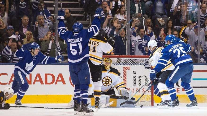 Toronto Maple Leafs' James Van Riemsdyk, right, scores on Boston Bruins goalie Anton Khudobin during the first period of an NHL hockey game, in Toronto, Saturday, Oct. 15, 2016. (Chris Young/The Canadian Press via AP)