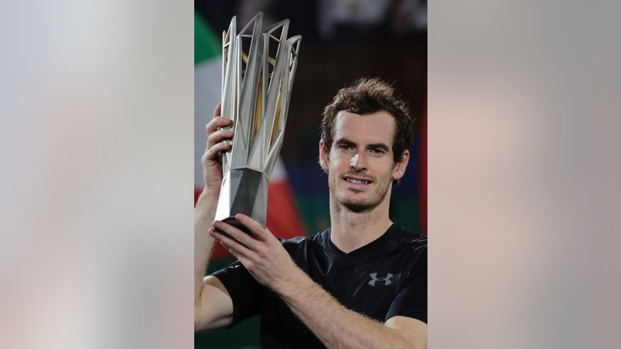 Andy Murray of Britain poses with his winner trophy after defeating Roberto Bautista Agut of Spain in the men's singles final of the Shanghai Masters tennis tournament at Qizhong Forest Sports City Tennis Center in Shanghai, China, Sunday, Oct. 16, 2016. (AP Photo/Andy Wong)