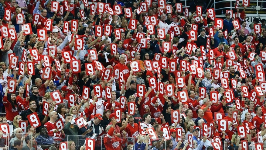 Detroit Red Wings fans hold up the number 9 in honor of the late Gordie Howe in the first period of an NHL hockey game again the Ottawa Senators at Joe Louis Arena, Monday, Oct. 17, 2016 in Detroit. (AP Photo/Paul Sancya)