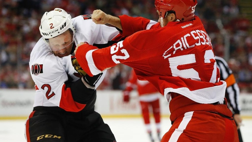 Ottawa Senators defenseman Dion Phaneuf (2) and Detroit Red Wings defenseman Jonathan Ericsson (52) fight in the first period of an NHL hockey game at Joe Louis Arena, Monday, Oct. 17, 2016 in Detroit. (AP Photo/Paul Sancya)