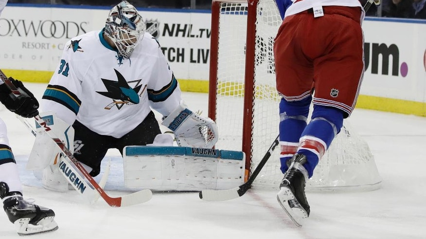 New York Rangers's Rick Nash (61) shoots the puck past San Jose Sharks goalie Martin Jones (31) during the second period of an NHL hockey game Monday, Oct. 17, 2016, in New York. (AP Photo/Frank Franklin II)